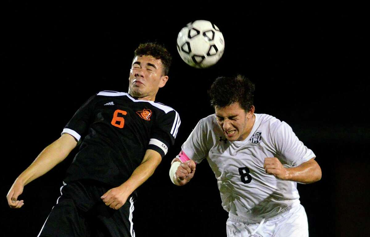 Stamford's Carlos Lopez, left, and Trumbull's Pete Xenakis head the ball during boys soccer action against Trumbull in Trumbull, Conn., on Wednesday Sept. 13, 2017.