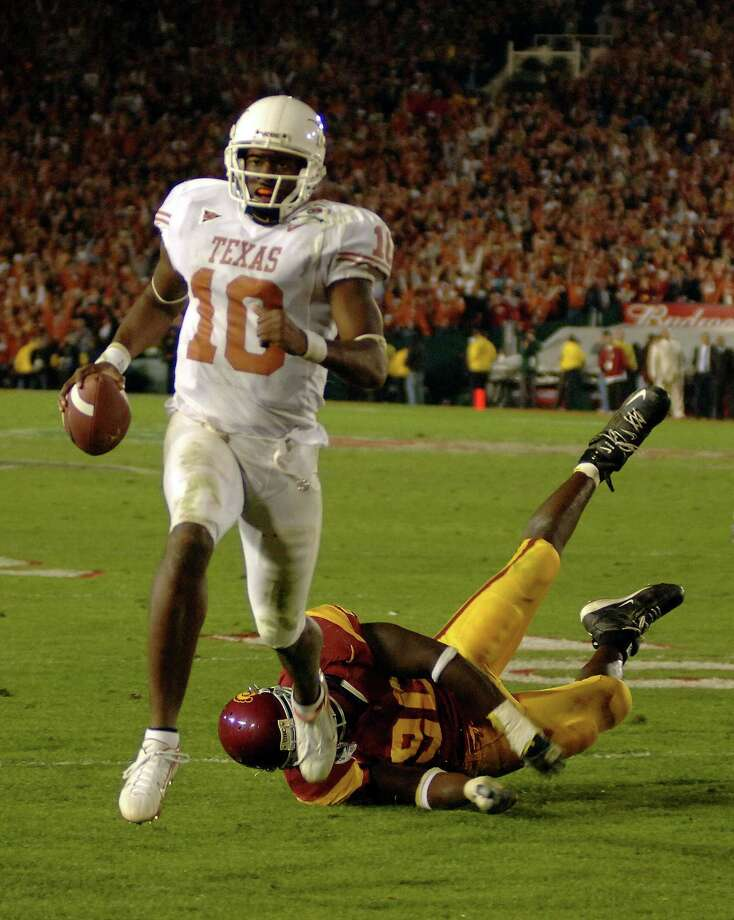 Texas QB Vince Young heads toward the end zone on his decisive 8-yard touchdown run in the Longhorns' 41-38 victory over USC in the 2006 Rose Bowl. Photo: Mark J. Rebilas-US PRESSWIRE, Contract Photographer / (2006) Mark J. Rebilas