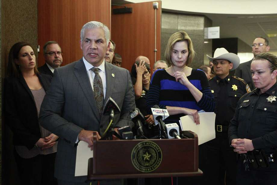 Montgomery County District Attorney Brett Ligo addresses the media as Kathleen Goforth, widow of Harris County Sheriff's Deputy Darren Goforth, prepared to speak during a press conference at the Harris County Civil Courthouse, Wednesday, Sept. 13, 2017, in Houston. Shannon Miles, 32, pleaded guilty to capital murder and was sentenced to life without parole for fatally shooting her husband on Aug. 28, 2015, as he was filling up his patrol car at a gas station in Northeast Harris County. Photo: Jason Fochtman, Staff Photographer / Conroe Courier / HCN
