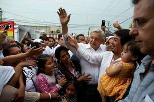 Andres Manuel Lopez Obrador, with white hair, is a front-runner to become Mexico's president.