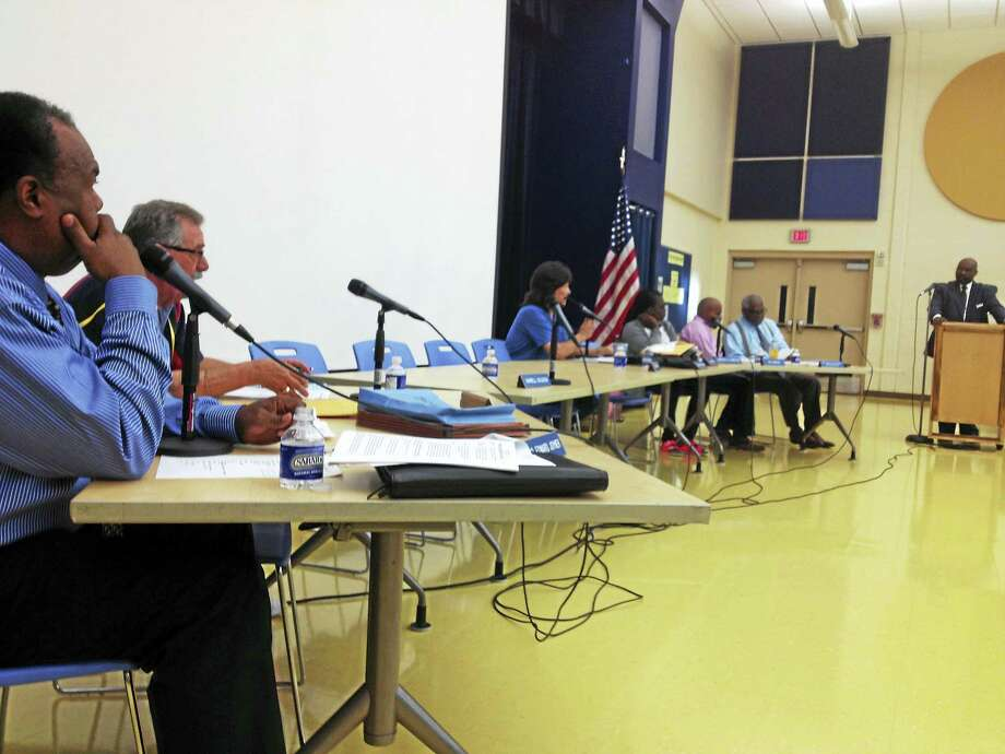 Members of the Board of Education hear from Hazard, Young, Attea & Associates consultant Edward McCormick, at right, on Sept. 11. From left are Edward Joyner, Frank Redente, Carlos Torre, student member Makayla Dawkins, Che Dawson and interim Superintendent of Schools Reginald Mayo. Missing are Mayor Toni Harp, Darnell Goldson and student member Jacob Spell. Photo: Brian Zahn / Hearst Connecticut Media