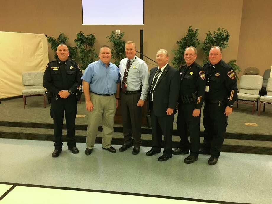 Montgomery County Sheriff Rand Henderson, third from the left, spoke alongside his top brass to a crowd of dozens about his goals for the office and what the community can do to help keep Montgomery County safe during his office's second Community Action Partner meeting of 2017 at Conroe's First Presbyterian Church on Wednesday, Sept. 13, 2017. Photo: Jay R. Jordan