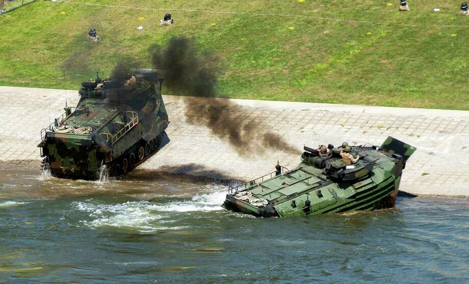 This Sept. 6, 2016, photo released by the U.S. Marine Corps shows Marines with the 2nd Amphibious Assault Battalion aboard AAV-7 Amphibious Assault vehicles during an exercise on the Cumberland River in Nashville, Tenn. The Marine Corps said Wednesday, Sept. 13, 2017 that an AAV-7 similar to these one caught fire during a training exercise at Camp Pendleton, Calif., and 15 Marines were taken to area hospitals, including several with serious injuries. (Lance Cpl. Jered Stone/U.S. Marine Corps via AP) ORG XMIT: LA316 Photo: Lance Cpl. Jered Stone / U.S. Marine Corps