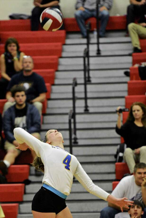 FILE PHOTO: Newtown's Zoe Beals (4) goes up for the spike in the SWC girls volleyball semi finals between Pomperaug and Newtown high schools. Wednesday, November 2, 2016, at Mask High School, Monroe, Conn. Photo: H John Voorhees III / Hearst Connecticut Media / The News-Times