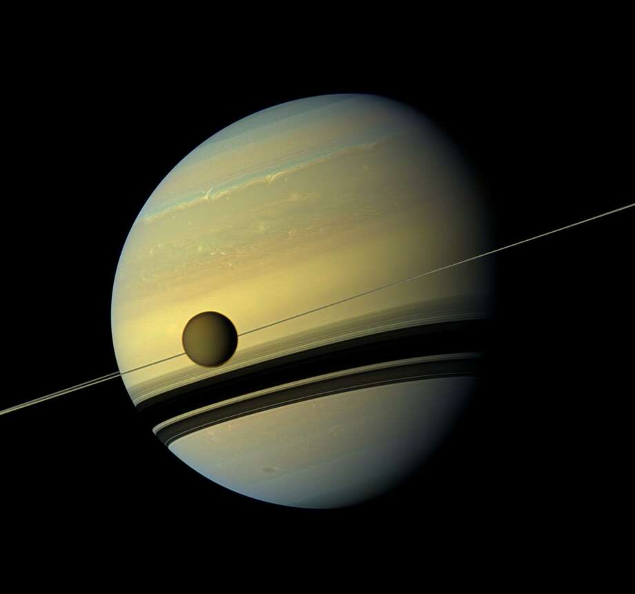 FILE - A photograph of Titan, Saturn's largest moon on Aug. 29, 2012. NASA is developing a submersible that could traverse the moon's methane lakes, but such a mission could be decades in the making. In the meantime, see highlights from the Cassini-Hyugens Mission. Photo: NASA/JPL-Caltech/Space Science Institute