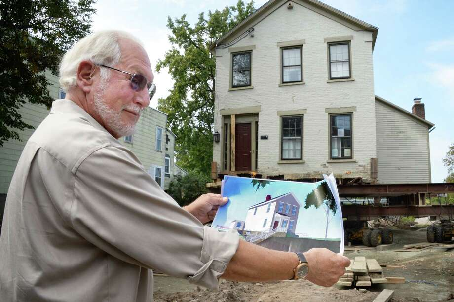 Architect Frank Gilmore shows his design for raising and moving this historic Stockade home out of the flood plain Wednesday Sept. 13, 2017 in Schenectady, NY. An $8.6 million FEMA grant to study how to help other historic homes that are in the flood plain is on hold following Hurricanes Harvey and Irma.  (John Carl D'Annibale / Times Union) Photo: John Carl D'Annibale / 40041543A