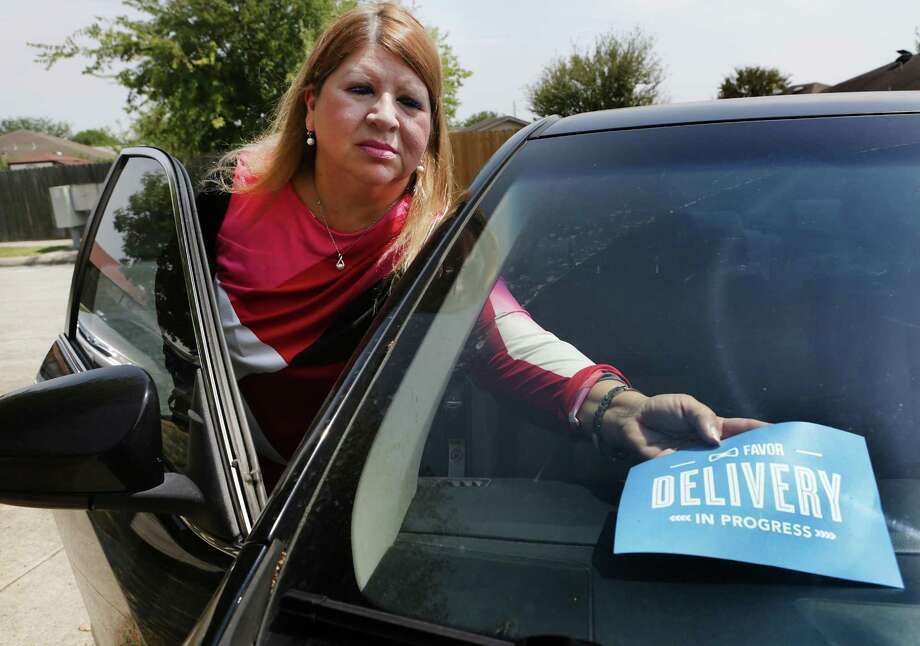 Tricia Fayadh of San Antonio works part-time at a medical clinic and uses her car to deliver meals to people so she can stay afloat financially. She has been looking for full-time work since December. Photo: Bob Owen /San Antonio Express-News / ©2017 San Antonio Express-News