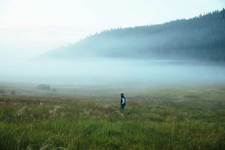 Perry Norris, Executive Director of Truckee Donner Land Trust, looks out onto a meadow in the Carpenter Valley near Truckee on Wednesday, September 6, 2017.