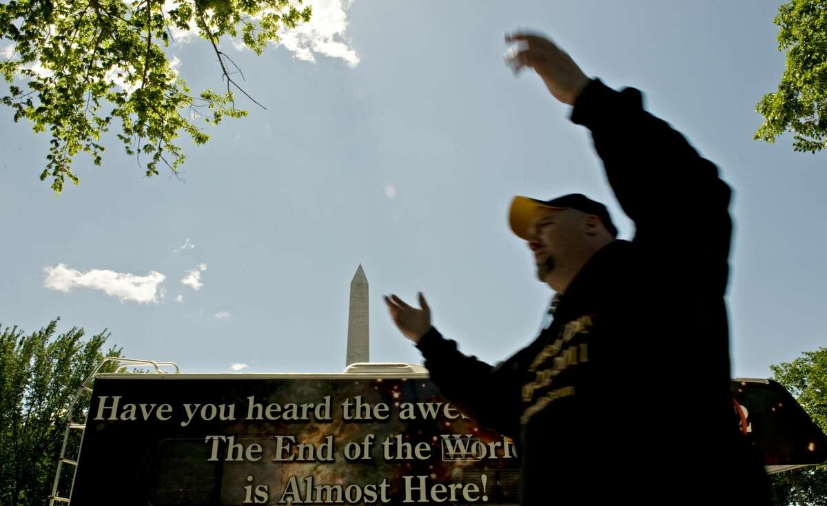 Gary Voller, of Alexandria, Virginia, gathers his team to discuss their departure for their next stop in Washington, D.C., on on Thursday, May 5, 2011. A group of about 60 people are criss-crossing the U.S. spreading their message about the end of the world: Oct. 21, 2011, as predicted by Harold Camping, an 89-year-old Christian broadcaster from California.