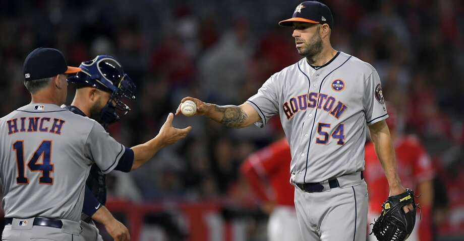 Houston Astros starting pitcher Mike Fiers, right, is taken out of the game by manager A.J. Hinch, left, as catcher Max Stassi stands next to Hinch during the fourth inning of a baseball game against the Los Angeles Angels, Wednesday, Sept. 13, 2017, in Anaheim, Calif. (AP Photo/Mark J. Terrill) Photo: Mark J. Terrill/Associated Press