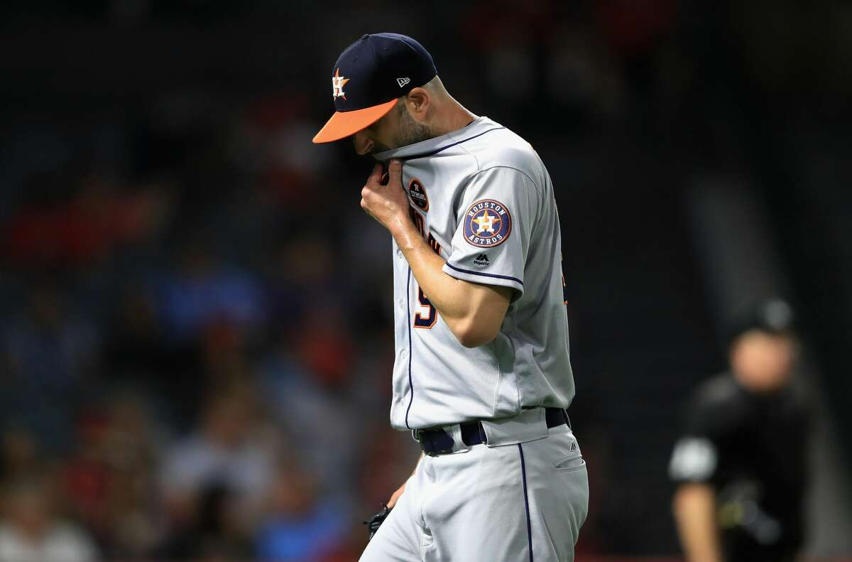 ANAHEIM, CA - SEPTEMBER 13: Mike Fiers #54 walks off the field after being relieved by James Hoyt #51 of the Houston Astros during the fourth inning of a game at Angel Stadium of Anaheim on September 13, 2017 in Anaheim, California. (Photo by Sean M. Haffey/Getty Images)