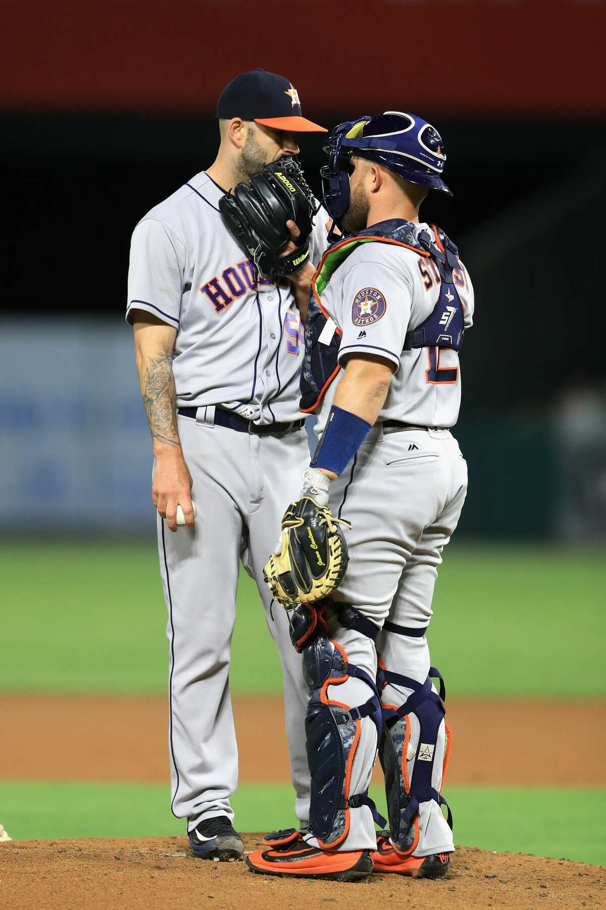 ANAHEIM, CA - SEPTEMBER 13: Mike Fiers #54 talks with Max Stassi #12 of the Houston Astros during the first inning of a game against the Los Angeles Angels of Anaheim at Angel Stadium of Anaheim on September 13, 2017 in Anaheim, California. (Photo by Sean M. Haffey/Getty Images)