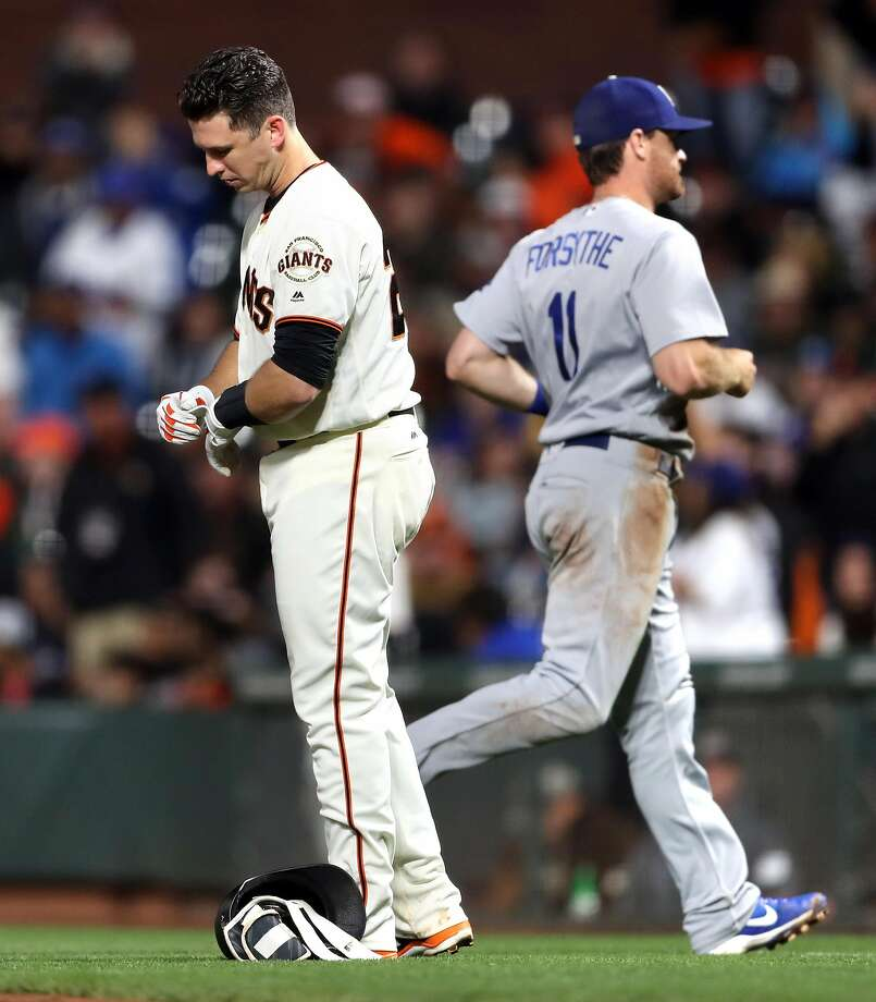 San Francisco Giants' Buster Posey reacts after Jarrett Parker was doubled off first base after Posey flew out to center field against Los Angeles Dodgers in 7th inning during MLB game at AT&T Park in San Francisco, Calif., on Wednesday, September 13, 2017. Photo: Scott Strazzante, The Chronicle