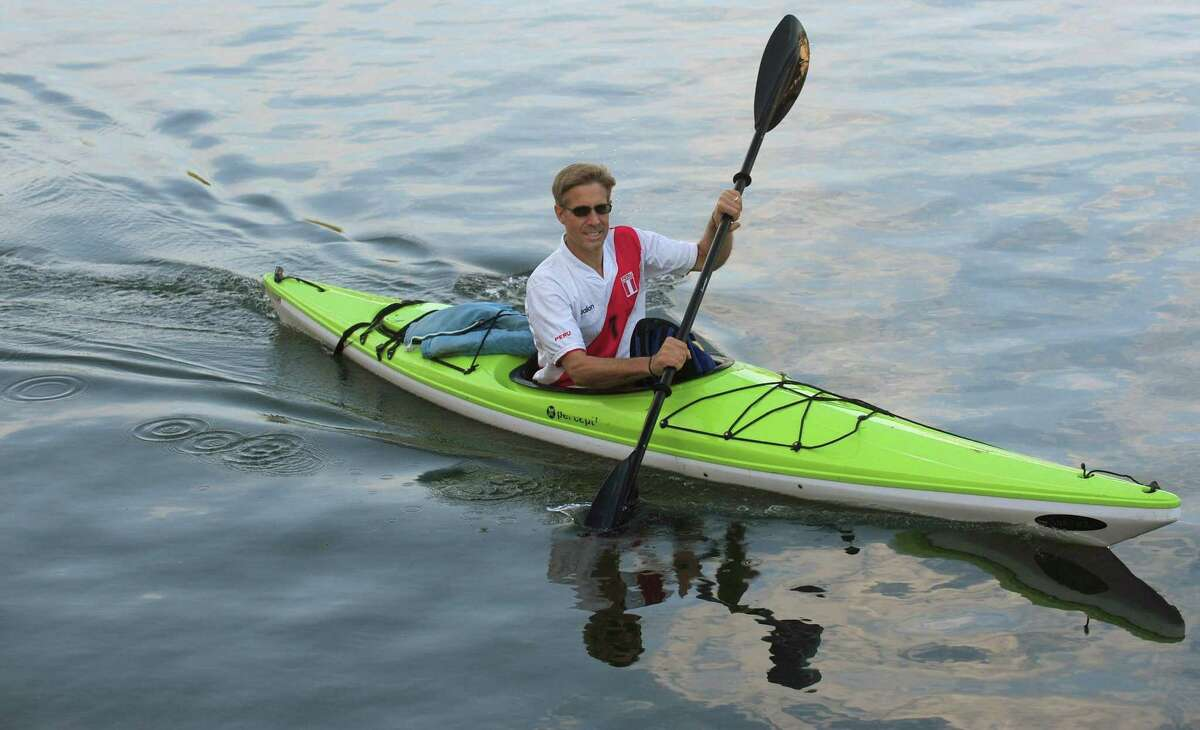 Norwalk resident Peter Libre paddles to work in his kayak Wednesday, September 13, 2017 along the Norwalk River in Norwalk, Conn. Libre takes alternative modes of travel most days from bicycle to ski skates.