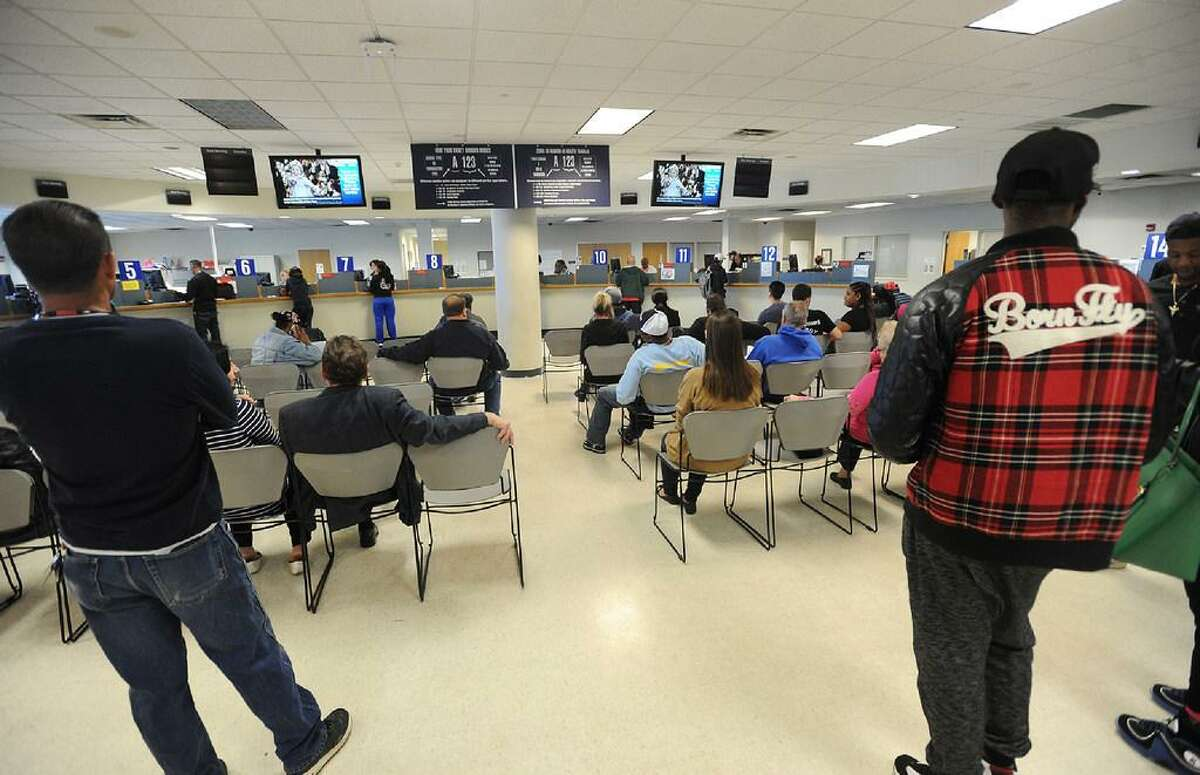 The Department of Motor Vehicles in Bridgeport, Conn. on Wednesday, April 20, 2016. Issues with the DMV's new computer system have caused delays at branches this week as well as problems with voter registration for the upcoming election primaries. In September 2017, the DMV sought private vendors for license services to ease long lines at its branches.
