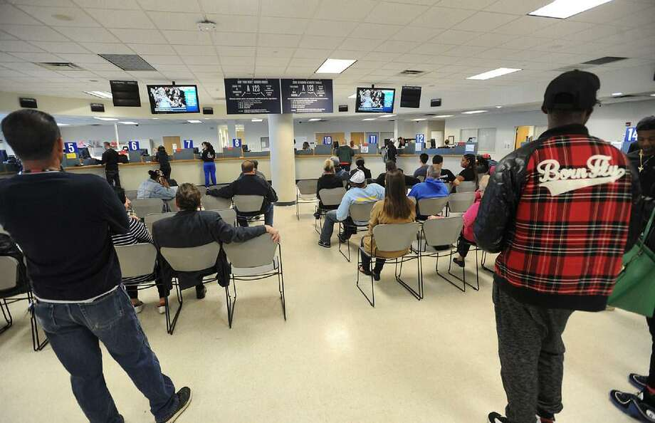 The Department of Motor Vehicles in Bridgeport, Conn. on Wednesday, April 20, 2016. Issues with the DMV's new computer system have caused delays at branches this week as well as problems with voter registration for the upcoming election primaries. In September 2017, the DMV sought private vendors for license services to ease long lines at its branches. Photo: /