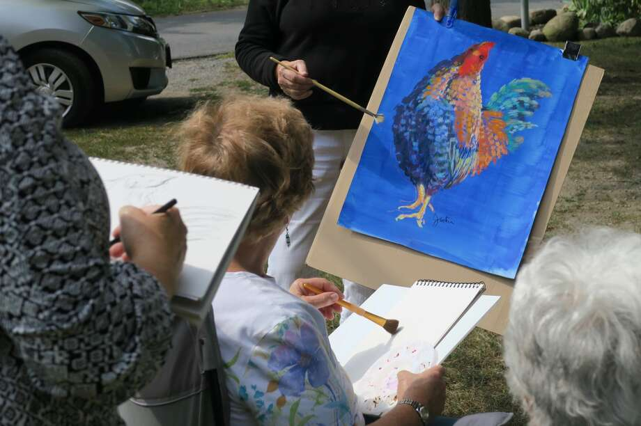 "Artist Carolyn Justice leads a painting class. She will lead a ""Sketching with Pen, Ink and Watercolor"" workshop at Plein Air Festival 2017 on Saturday, Sept. 16, in the village of Round Lake. For registration and information, go to https://roundlakepleinair.eventbrite.com Photo: Courtesy Malta League Of Arts"