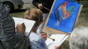 """Artist Carolyn Justice leads a painting class. She will lead a """"Sketching with Pen, Ink and Watercolor"""" workshop at Plein Air Festival 2017 on Saturday, Sept. 16, in the village of Round Lake. For registration and information, go to  https://roundlakepleinair.eventbrite.com"""