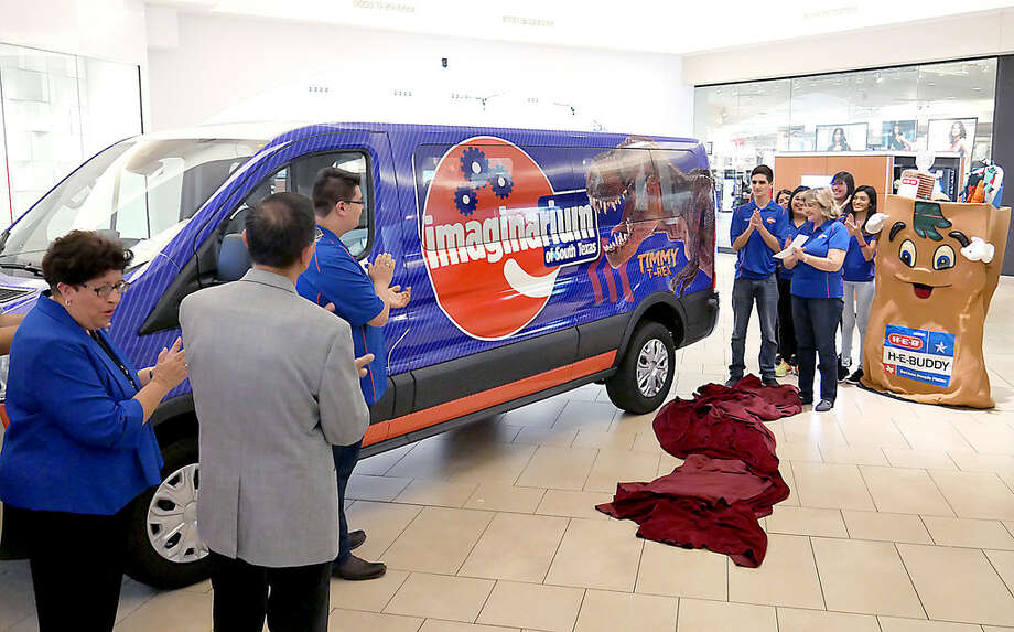 The Imaginarium of South Texas Executive Director Sandra Cavazos-Ayala, left, was joined by board members and staff as they unveiled the newest addition to the museum, the Imaginarium of South Texas Van, Wednesday, September 13, 2017 at Mall del Norte. Thanks to generous donors the museum now owns a van that can be used to travel to schools and community events in Laredo and Webb County. The custom wrap as designed and applied by board member Fernando Flores. Photo: Cuate Santos/Laredo Morning Times