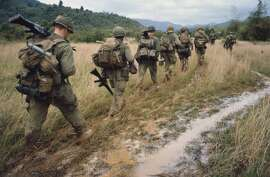 """Soldiers on a search and destroy operation near Qui Nhon. January 17, 1967. Image used in the film """"The Vietnam War"""" by Ken Burns and Lynn Novick airing on PBS"""