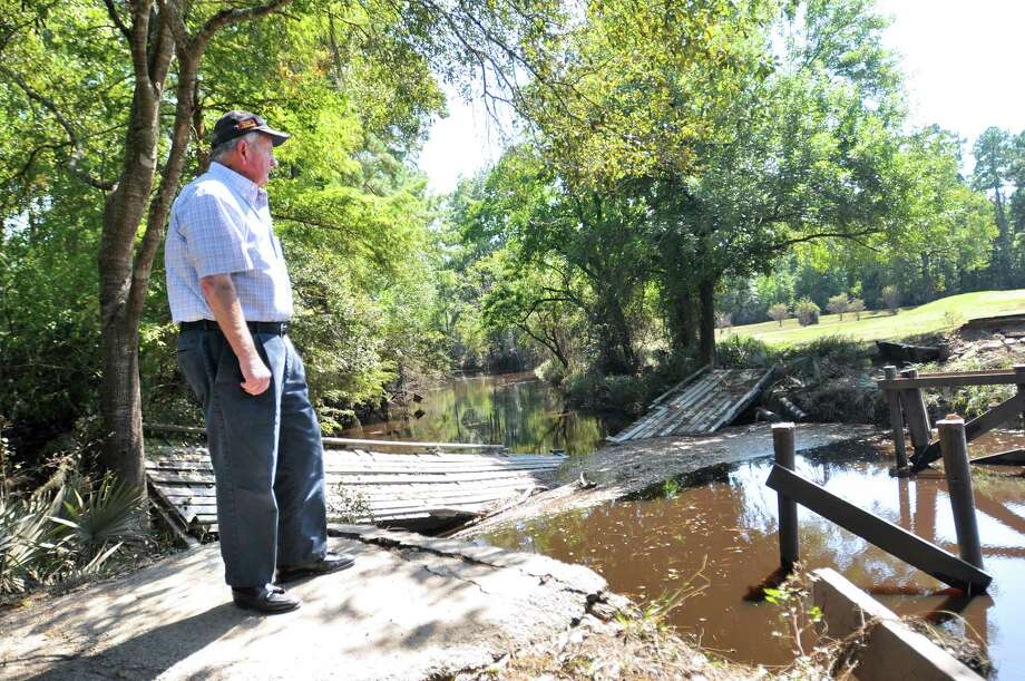 Idylwild Golf Club co-owner Ray Moore stands at the foot of a where the bridge on Hole No. 6 once stood at a point where Pine Island Bayou crosses into the course. Bridges on holes No. 4 and 5 were damaged in similar fashion when floodwaters rose during Tropical Storm Harvey. (Mike Tobias/The Enterprise) Photo: Mike Tobias/The Enterprise