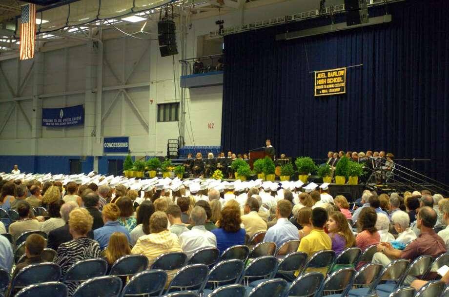 Students and family attend the Joel Barlow High School graduation at the O'Neill Center on Western Connecticut State University's campus in Danbury, June 22, 2010. Photo: Chris Ware / The News-Times