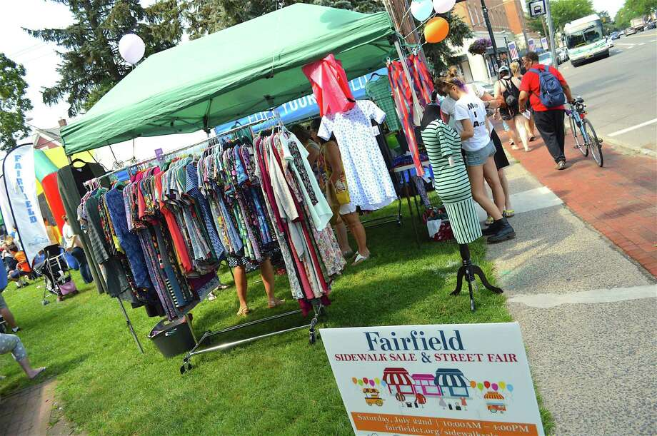 People shop downtown during the Fairfield Sidewalk Sale & Street Fair on July 22. Photo: Jarret Liotta / For Hearst Connecticut Media File Photo / Fairfield Citizen News Freelance
