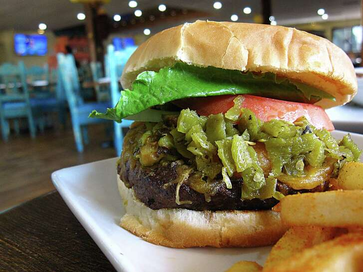 Half-pound Acoma burger with roasted green chiles and cheese with fries from Santa Fe Trail Mexican Cuisine.