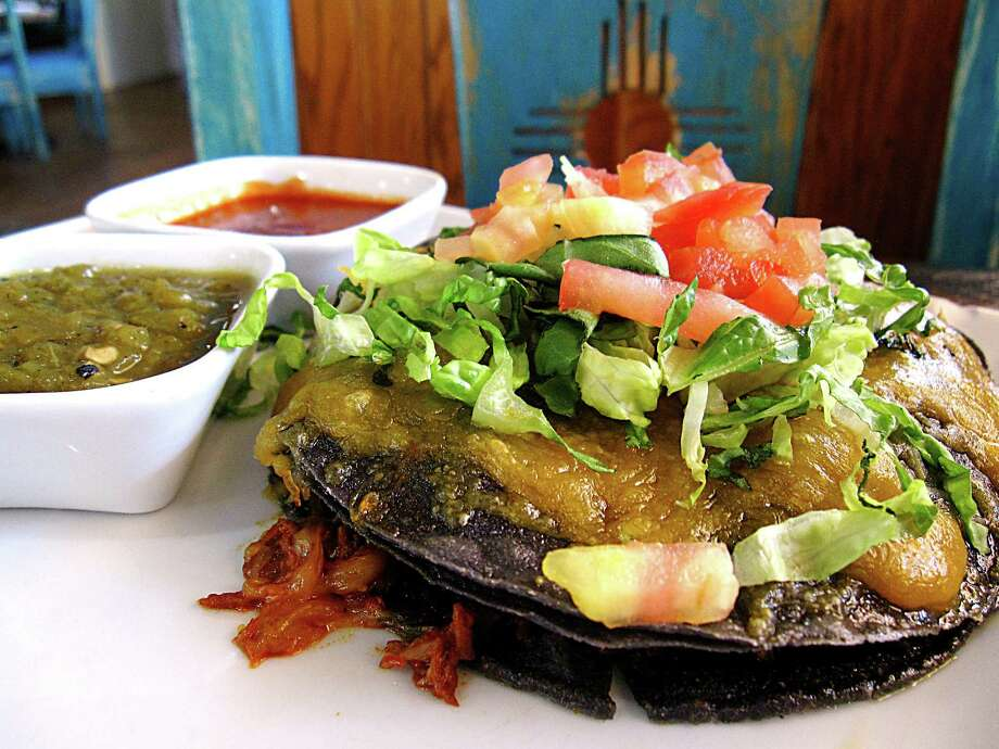"Blue corn stacked enchiladas with pork adobado, lettuce, tomatoes and cheese with a ""Christmas"" set of green and red chile sauces from Santa Fe Trail Mexican Cuisine on San Pedro Avenue. Photo: Mike Sutter /San Antonio Express-News"