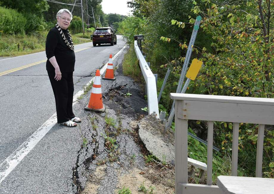 Barbara Faraone shows area where route 9P is collapsing under the weight of traffic due to increased traffic from development on Saratoga Lake on Wednesday, Sept. 13, 2017 in Saratoga, N.Y. This is taken across from her house. (Lori Van Buren / Times Union) Photo: Lori Van Buren, Albany Times Union / 40041546A