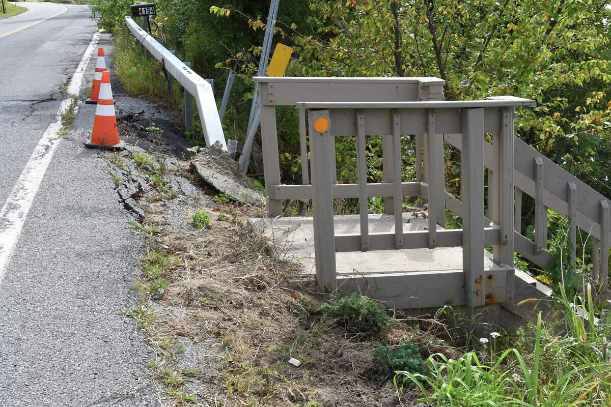 Area where route 9P is collapsing under the weight of traffic due to increased traffic from development on Saratoga Lake on Wednesday, Sept. 13, 2017 in Saratoga, N.Y. Sinking older steps are seen on the left of the new steps leading down to lake. (Lori Van Buren / Times Union)