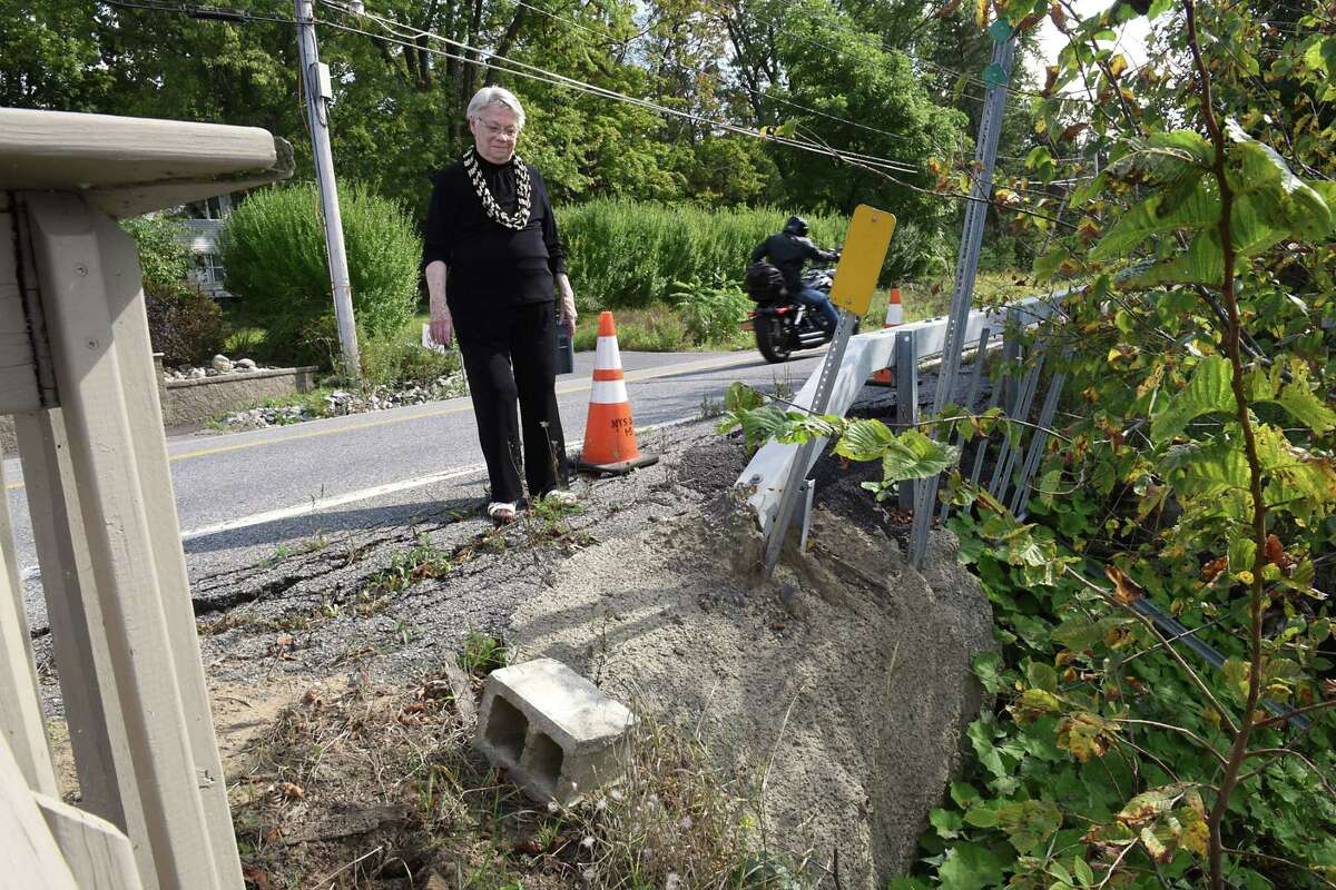 Barbara Faraone shows area where route 9P is collapsing under the weight of traffic due to increased traffic from development on Saratoga Lake on Wednesday, Sept. 13, 2017 in Saratoga, N.Y. This is taken across from her house. (Lori Van Buren / Times Union)