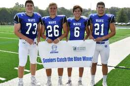 Darien High School football captains, from left, Michael Neary, Nick Green, Brian Minicus and Mitchell Pryor have extended an invitation to seniors to attend home games for free.