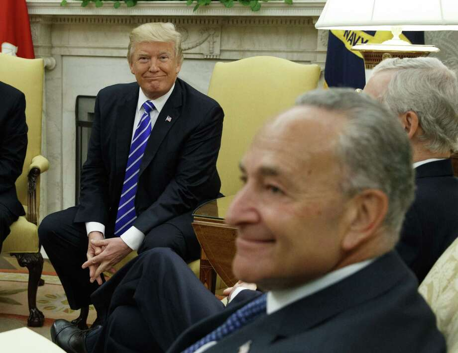 President Donald Trump and Senate Minority Leader Chuck Schumer, D-N.Y., during a meeting with other Congressional leaders in the Oval Office of the White House in Washington. Trump's deal with Democrats has offered a glimpse of the presidents interest in governing as an independent, unbound by ideology despite his takeover of the Republican party last year. Photo: Evan Vucci /Associated Press / Copyright 2017 The Associated Press. All rights reserved.