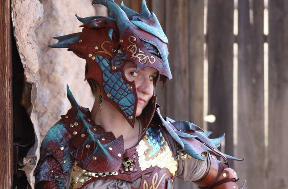 Jessi Arntz is a San Antonio-based cosplay professional and leather worker. Doing business as JAFantasyArt, she crafts all sorts of ornately detailed suits of armor and other related wares, such as this dragon armor she models on her website and business card. Photo: Courtesy JAFantasyArt