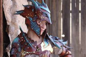 Jessi Arntz is a San Antonio-based cosplay professional and leather worker. Doing business as JAFantasyArt, she crafts all sorts of ornately detailed suits of armor and other related wares, such as this dragon armor she models on her website and business card.