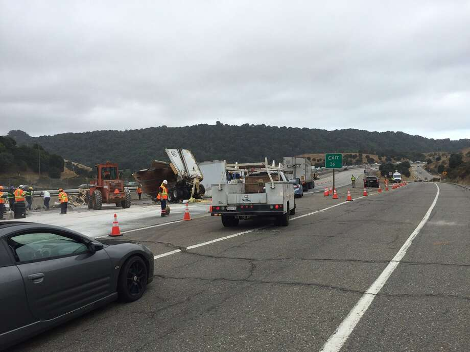 One lane has been reopened on I-580 where the driver of a big rig crashed into another big rig on Interstate 580 Thursday morning. Photo: CHP