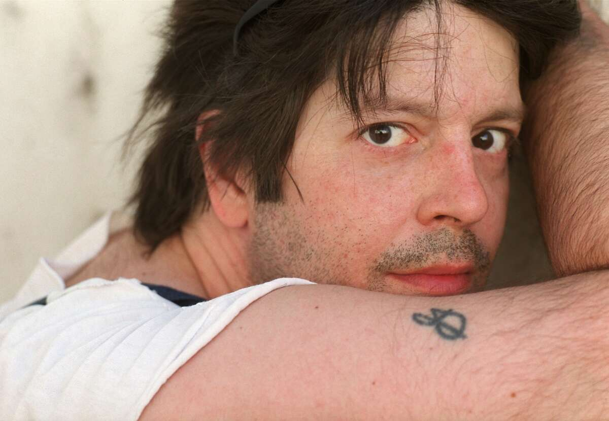 In this May 2000 photo, former Husker Du drummer Grant Hart poses for a photo in Minneapolis. Ken Shipley, who runs the band�s record label Numero Group, told The Associated Press that Hart died at the age of 56 on Wednesday, Sept. 13, 2017, of cancer at his home in St. Paul, Minn. (Jeff Wheeler/Star Tribune via AP)
