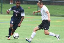 Nick Attai, left, battles for the ball during Greens Farms Academy 2-0 win over Christian Heritage on Wednesday.