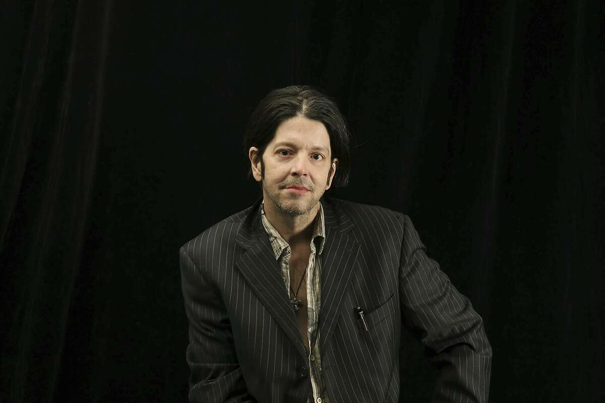 In this Oct. 6, 2009 photo, former Husker Du drummer Grant Hart poses for a photo in Minneapolis. Ken Shipley, who runs the band�s record label Numero Group, told The Associated Press that Hart died at the age of 56 Wednesday, Sept. 13, 2017, of cancer at his home in St. Paul, Minn. (Elizabeth Flores/Star Tribune via AP)