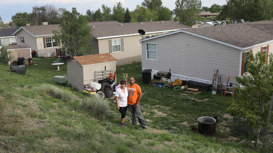 Mexican immigrants outside their family home in Thornton, CO Photo: John Moore/Getty Images