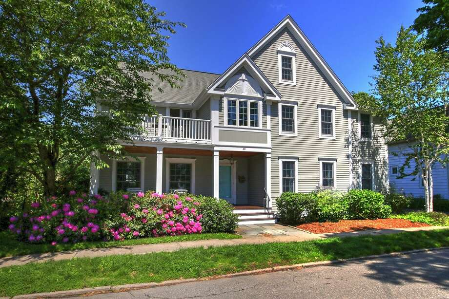 The house at 40 Shell Ave. in Milford began its life in 1865, as a beachfront cottage that was part of a bustle summer social scene in town. But, according to its current owner, the four-bedroom Nantucket Colonial, was moved across the street roughly 100 years ago. Today, the 2,599-square house still has beach access. It's just a little further away than it once was. But it has other features, including a cozy front porch. Photo: Contributed Photo / Contributed Photo / Connecticut Post Contributed