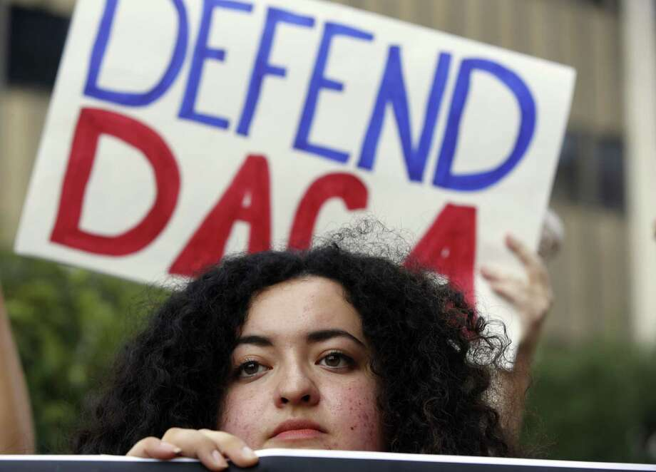 Loyola Marymount University student and dreamer Maria Carolina Gomez joins a rally in support of the Deferred Action for Childhood Arrivals, or DACA program, outside the Edward Roybal Federal Building in Los Angeles on Sept. 1. It is now up to Congress to pass a bill. Photo: Damian Dovarganes /Associated Press / Copyright 2017 The Associated Press. All rights reserved.