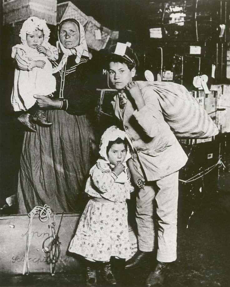 An Italian immigrant family waits for their missing luggage at Ellis Island, 1905. Arpaio's hypocrisy is staggering, a reader says; as a child of Italian immigrants, he should know that Italians, like Latinos today, faced tremendous discrimination at the turn of the century. Photo: /GEORGE EASTMAN HOUSE / EXPRESS-NEWS FILE PHOTO
