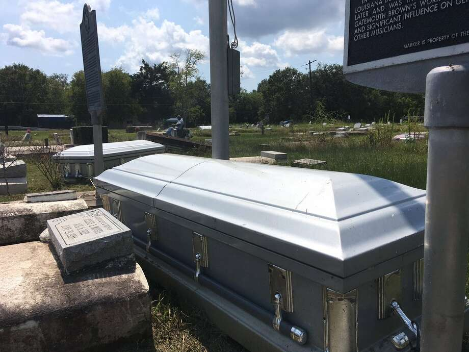 Two caskets that surfaced at Hollywood Cemetery in Orange because of Harvey.Photo: Tim Collins Photo: BE