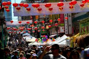 Crowds pack Grant Ave. for the 22nd annual Autumn Moon Festival in Chinatown in San Francisco, Calif., Saturday, September 22, 2012.