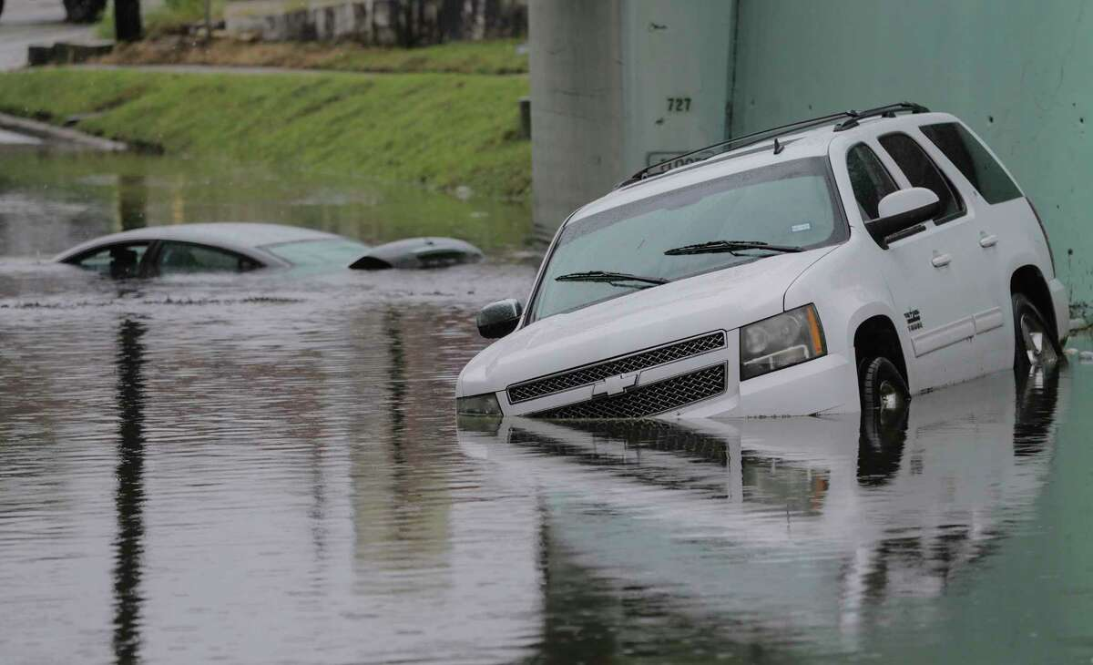 Cars soak under the viaduct on 75th Street in Houston as Hurricane Harvey inches its way through the area on Sunday, Aug. 27, 2017. ( Elizabeth Conley / Houston Chronicle )