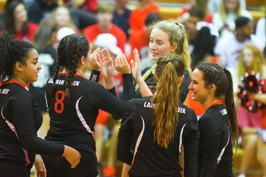 Langham Creek head coach Gena Rhodes said her Lobos Volleyball squad was fortunate to escape any flooding or major damage during the hurricane. Her girls, healthy types by nature, didn't lose a step during the lengthy break from school and sports, and they head into Thursday's Cy Ranch matchup looking to take sole possession of first place in District 17-6A. Photo: Tony Gaines / HCN