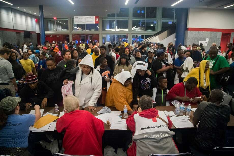 Thousands take shelter from the Tropical Storm Harvey at the George R. Brown Convention Center, Monday, Aug. 28, 2017, in Houston. ( Marie D. De Jesus / Houston Chronicle ) Photo: Marie D. De Jesus/Houston Chronicle