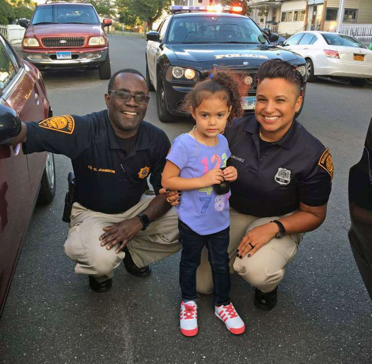 Bridgeport police officers visited Bridgeport resident Saydie Ramos on Sept. 7, 2017, to deliver a child's police uniform purchased by Ramos' father.